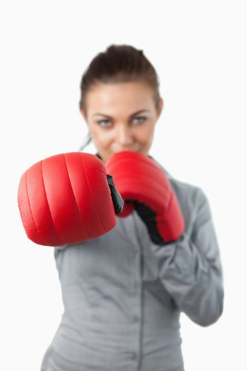 Boxing gloves used to slam by businesswoman