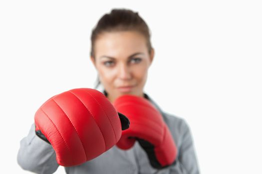 Boxing gloves used to slam by young businesswoman