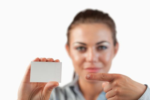 Close up of business card being pointed on by businesswoman
