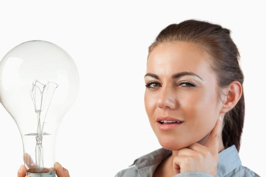 Businesswoman with huge light bulb