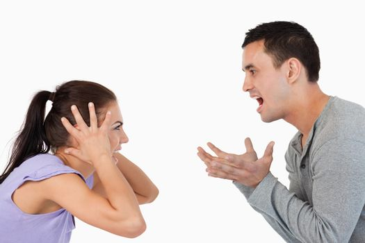Young couple yelling at each other