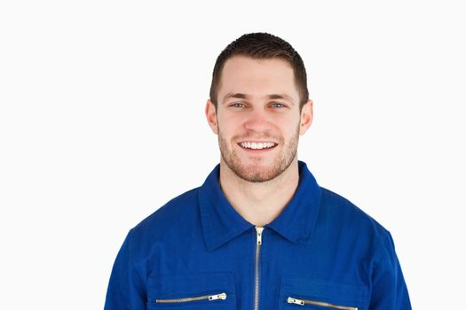 Smiling young blue collar worker