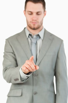 Businessman using futuristic touchscreen