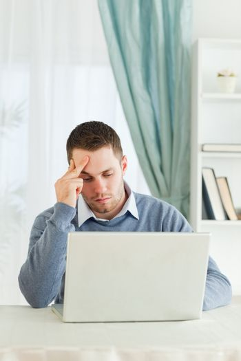 Worn out businessman on his laptop in his homeoffice