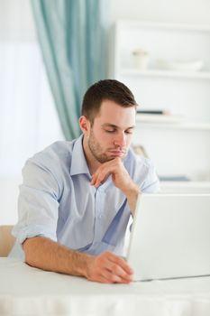 Sleepy businessman sitting at his laptop