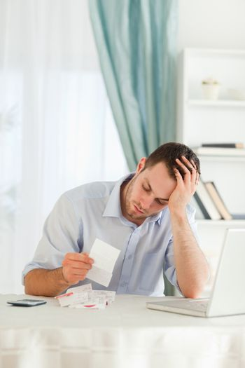 Concerned businessman looking at an invoice