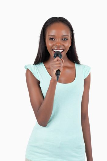 Brightly smiling young female singer
