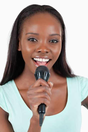 Close up of brightly smiling female singer