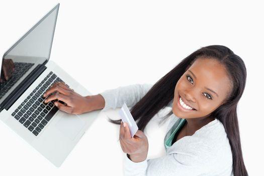 Smiling woman booking flight online