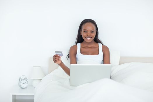 Smiling woman booking her holidays online