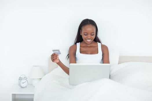 Young woman booking her holidays online