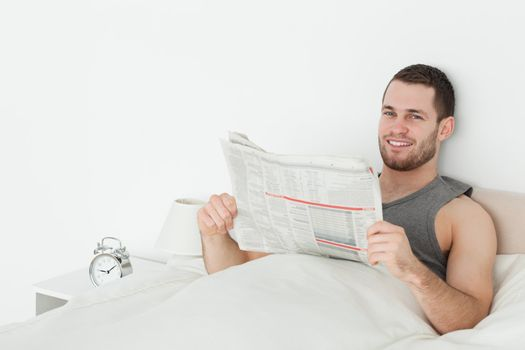 Quiet man reading a newspaper