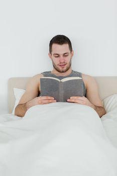 Portrait of a man reading a novel