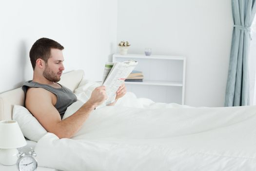 Serene man reading a newspaper