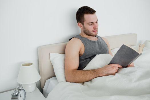 Young man reading a novel