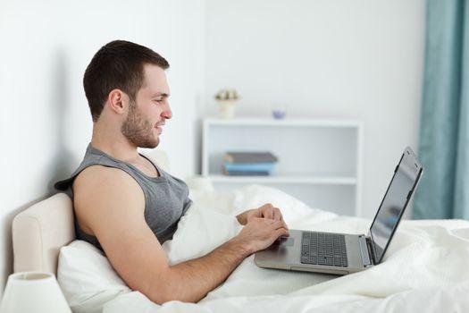 Quiet man using a laptop