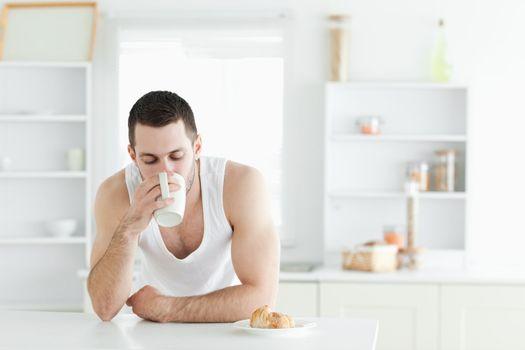 Serene man having breakfast