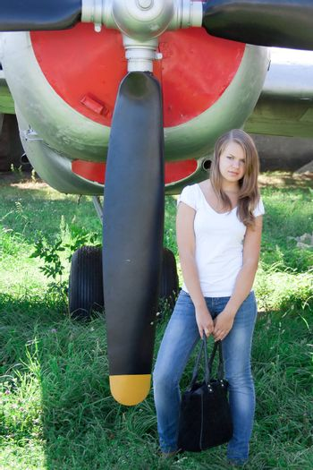 beautiful girl on the background plane survey at the Museum