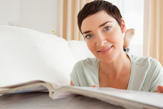 Close up of a woman with a magazine