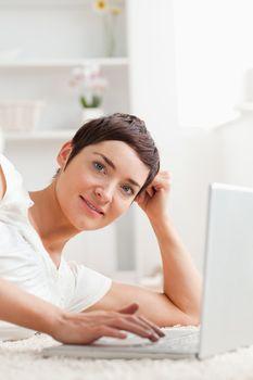 Portrait of a quiet woman with a laptop