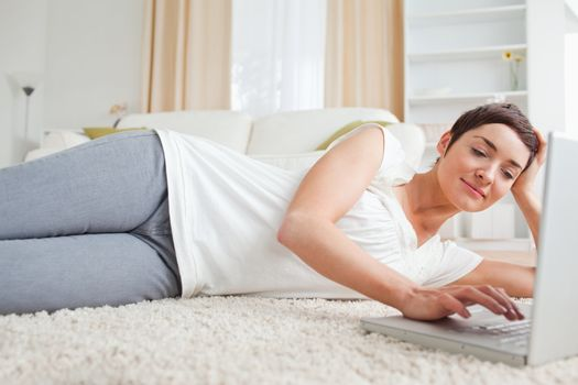 Quiet woman relaxing with a laptop