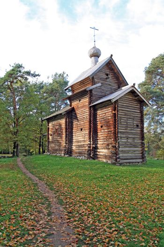 wooden chapel in autumn wood