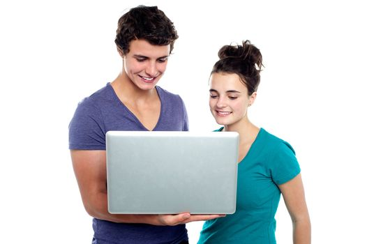 Couple looking into the laptop