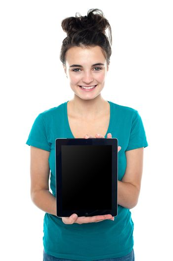 Casual teenager showing newly launched tablet device