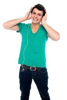 Cheerful guy enjoying loud music