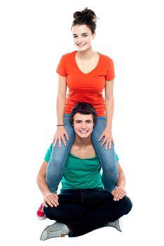 Girl riding on her boyfriend's shoulder