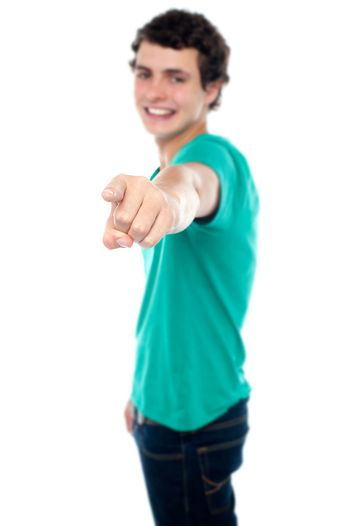 Casual teen guy pointing at you