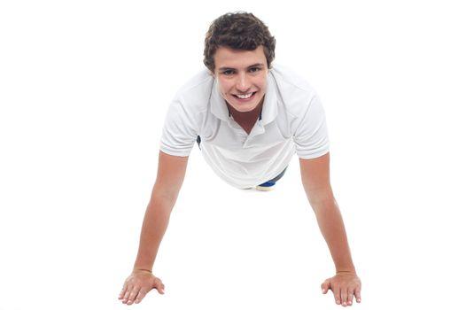 Active sports guy doing push ups