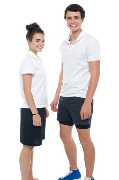 Teen couple in sportswear posing casually