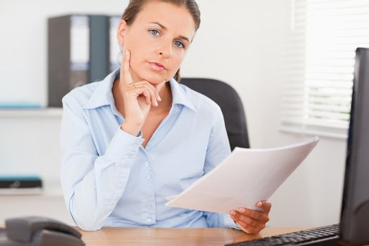 Businesswoman concentrating on a paper