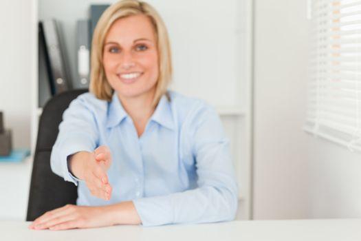 Businesswoman giving hand