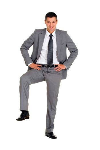 businessman with a foot on a step