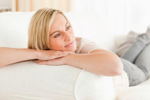 Serene woman lying on her sofa