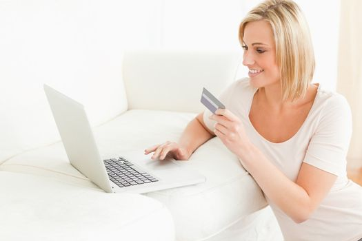 Cute woman booking her holidays online