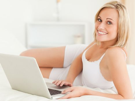 Serene woman with a laptop