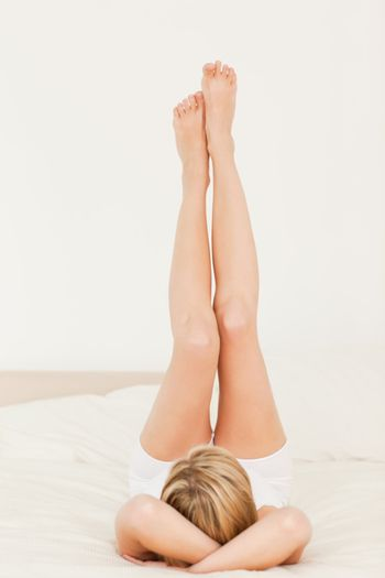 Woman with legs up