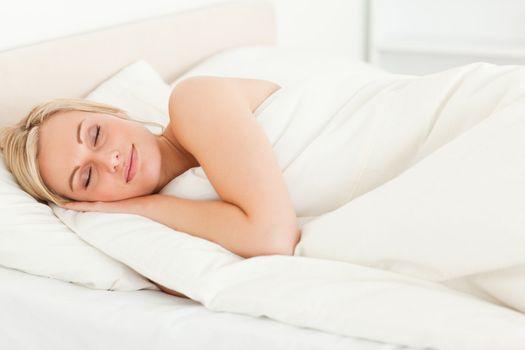 Serene blonde woman sleeping