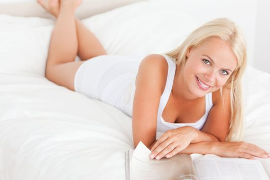 Smiling woman with a magazine