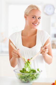 Woman mixing a salad
