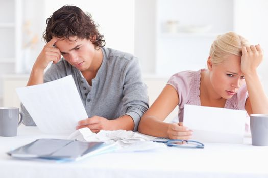 Stressed Couple with Paperwork