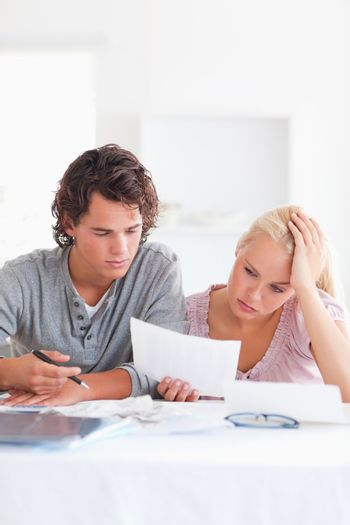Worried Couple with Paperwork