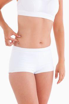 Thin woman gripping her waist