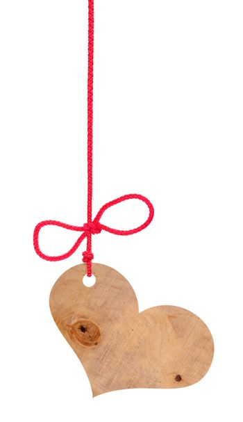 Wooden heart on a rope with a bow