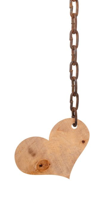 Wooden heart on the iron chain