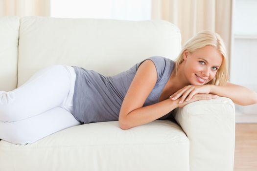 Serene woman resting on a sofa