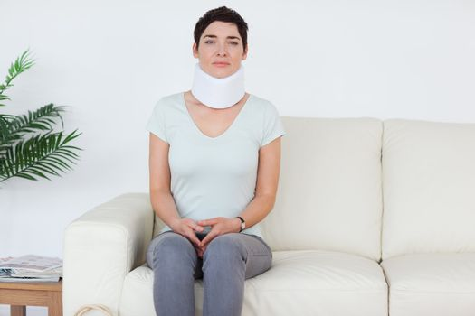 Sad Woman with a surgical collar